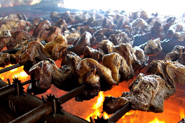 Meat roasting on an open flame